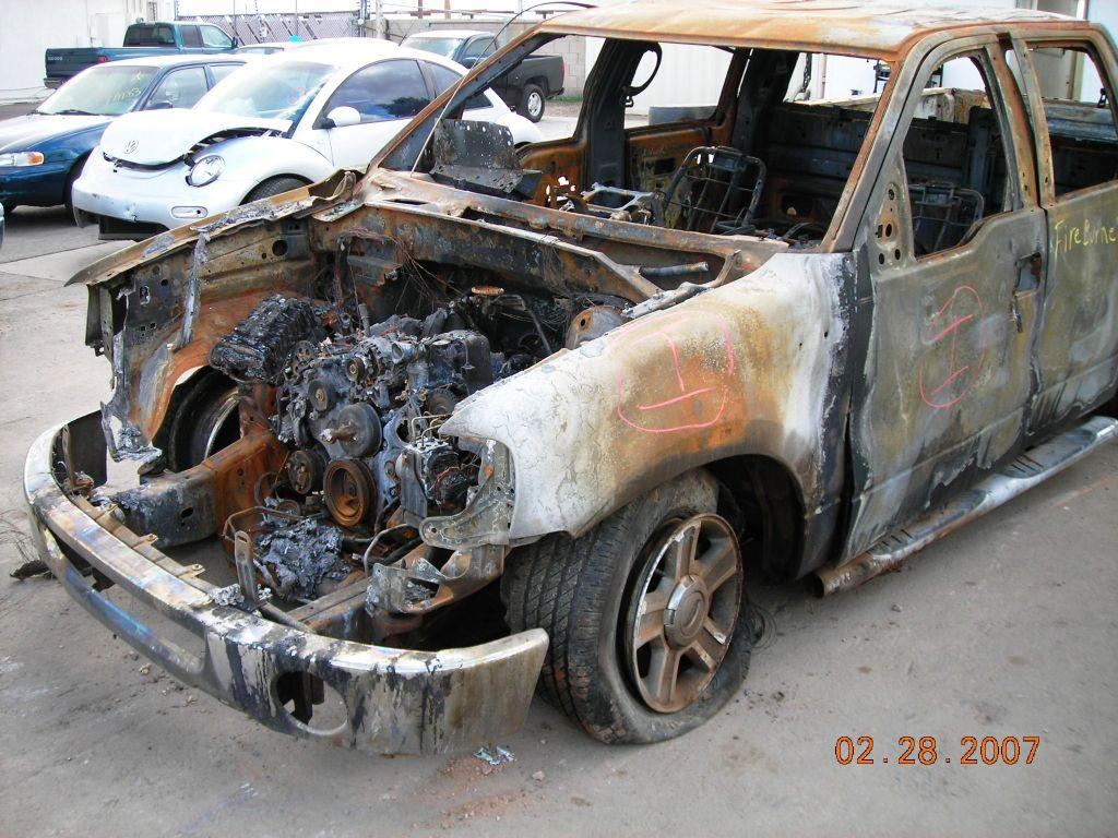 Inspecting stolen and burned 2006 Ford F-150 pickup