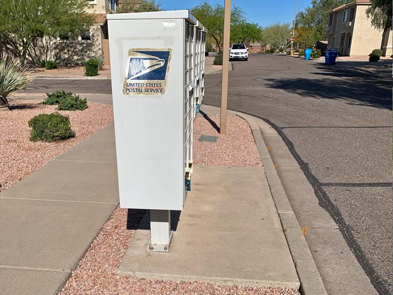 Examining exemplar concrete slab beneath cluster mailbox units