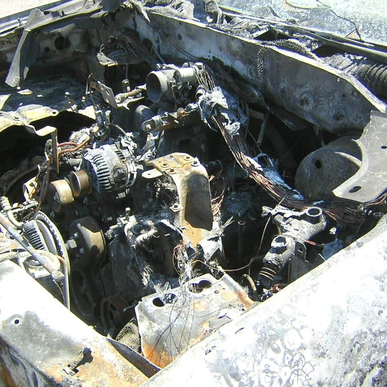 Engine compartment of burned 2001 Ford F-150