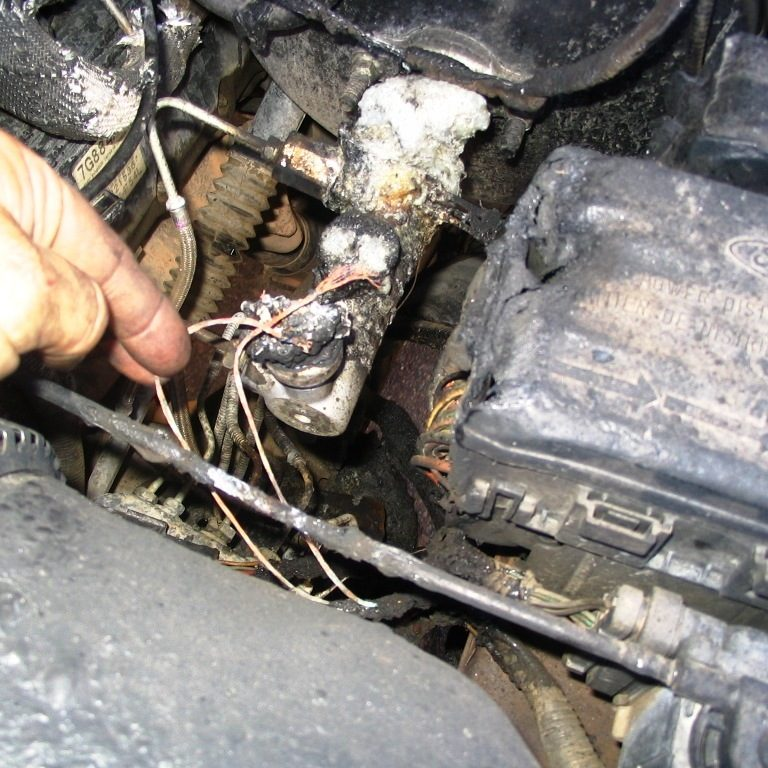 Inspecting burned brake master cylinder of 1997 Ford F-150 that caught fire while parked