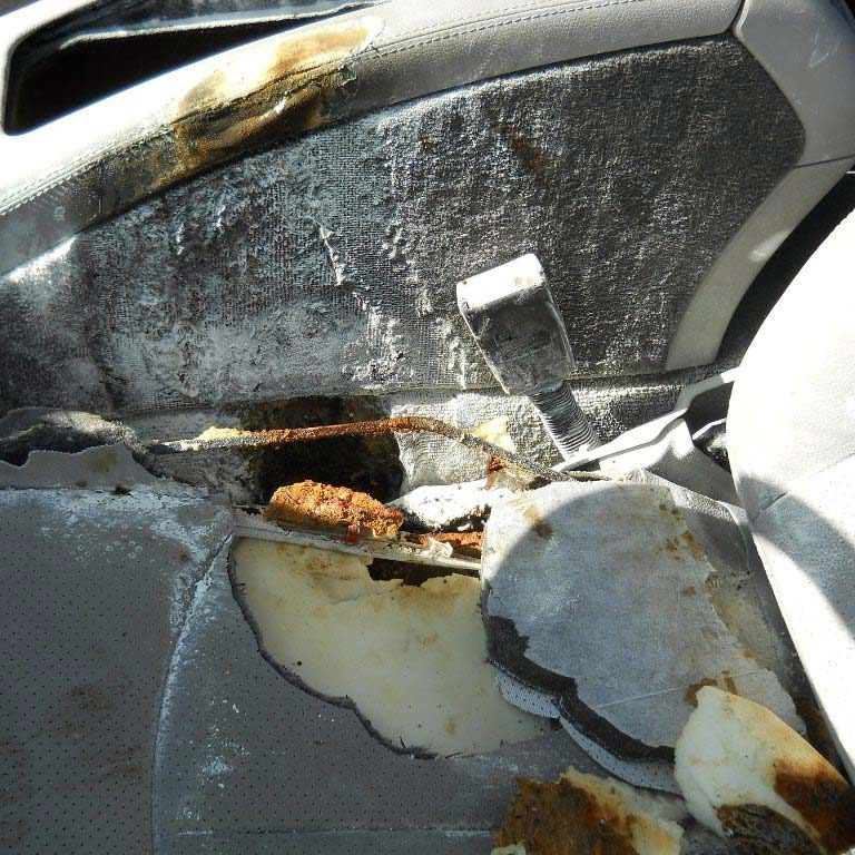 Burned driver seat area showing fire origin