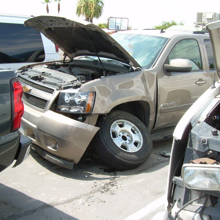 Inspecting Chevrolet Tahoe for brake and suspension failure
